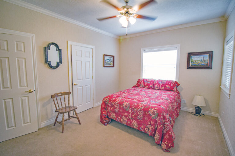 Bedroom with red comforter