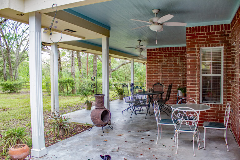 Back porch with seating area and outdoor fan