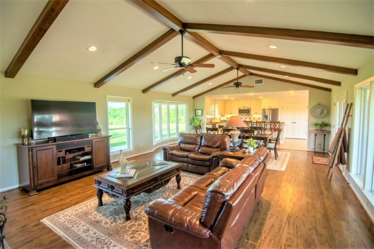 Living Room Side view with couches and vaulted ceilings - 11202 Palestine Road