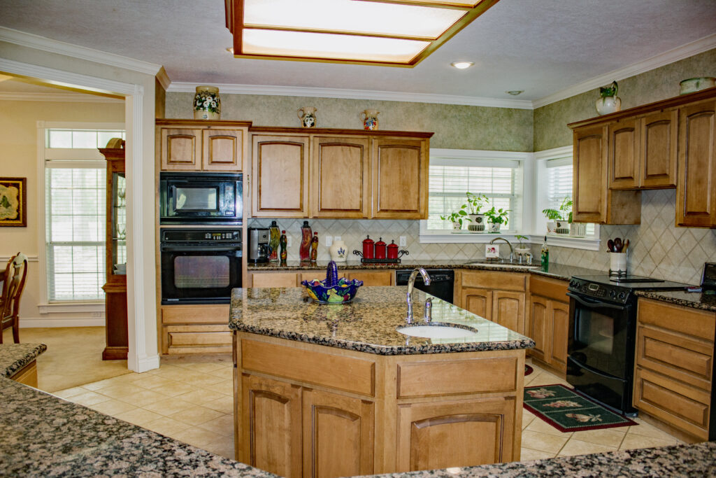 Kitchen with granite counter and wood cabinets