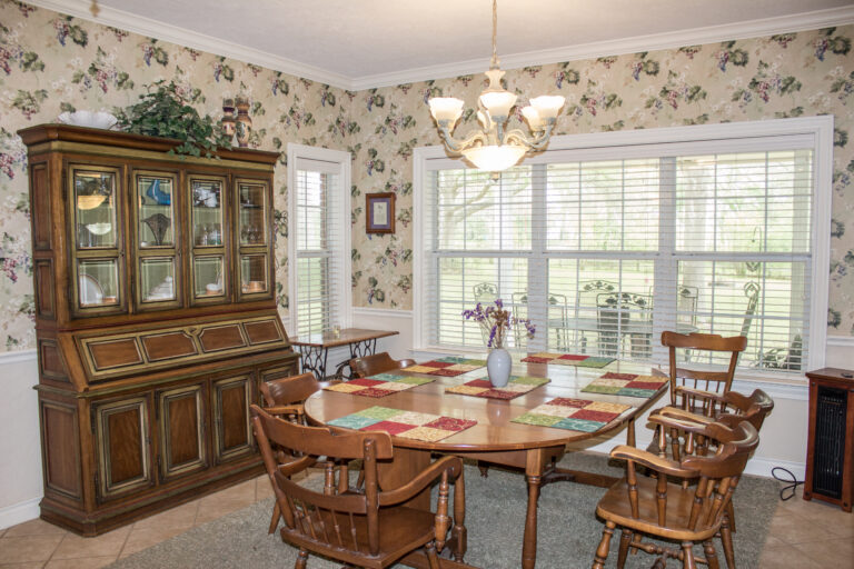 Breakfast area and dining room with table and hutch