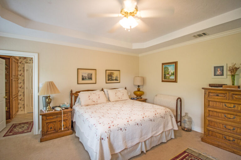 Master bedroom with bed and fan