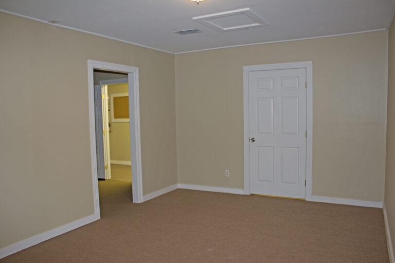Yellow Interior Walls with White Door