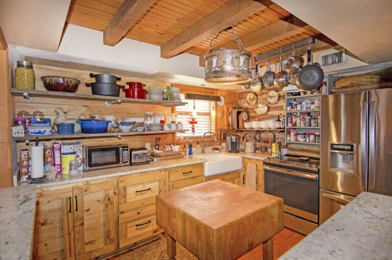 Kitchen with hanging pots and pans