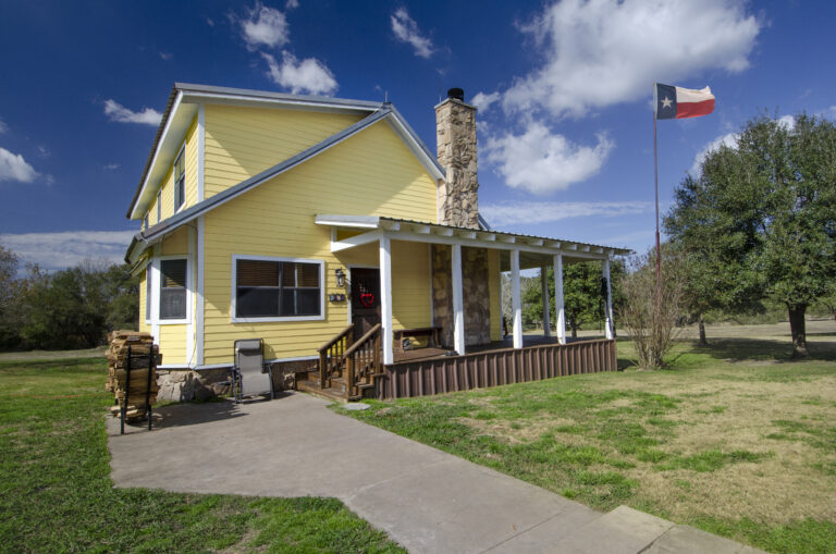 Brenham Party Rentals side of yellow home with porch