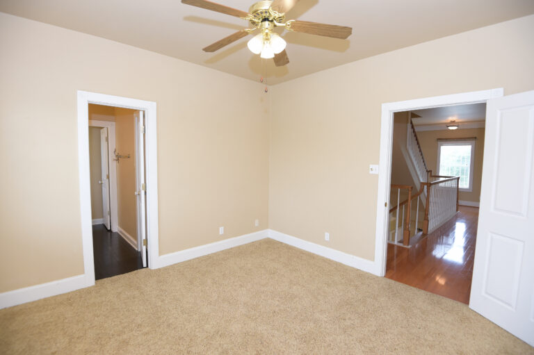 Bedroom 2 with beige carpet and fan with lights