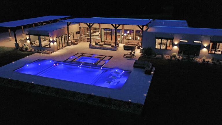 Modern design - home in texas with pool - lit up at night
