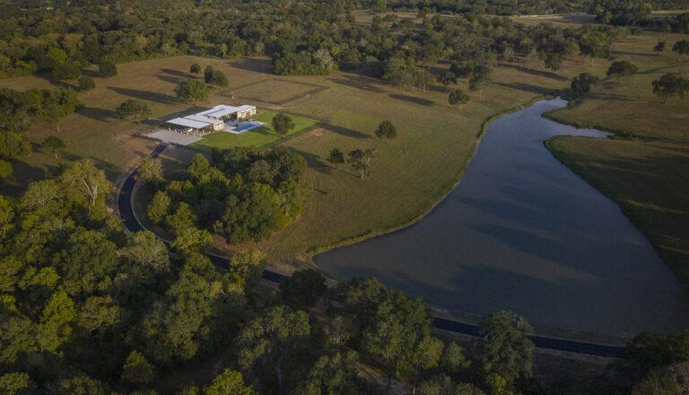 Birds eye view of lake house property