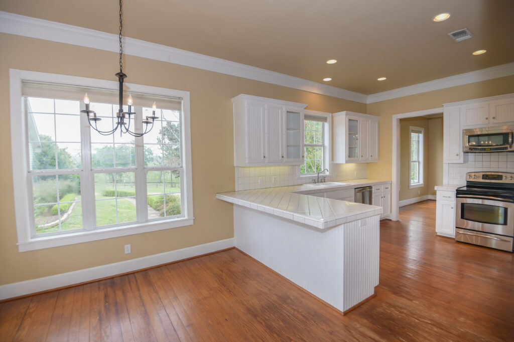 Kitchen with white countertops and dining area