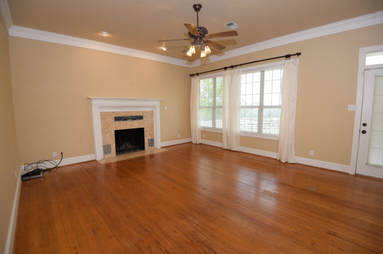 Living Room with Fireplace and Fan