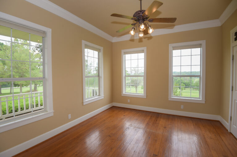 Living Room with Fan and Windows